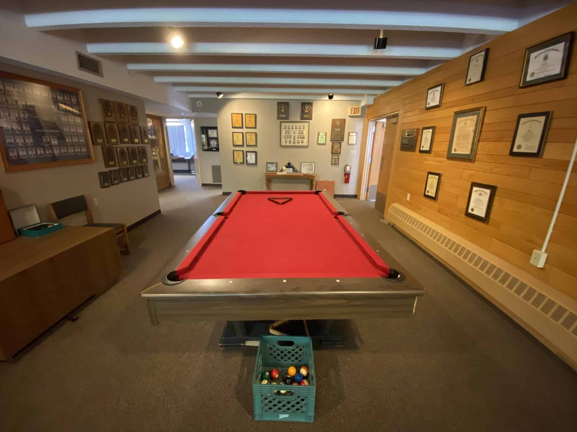 Lambda Chi Alpha's formal room features a pool table constructed by brothers and used daily for recreation.